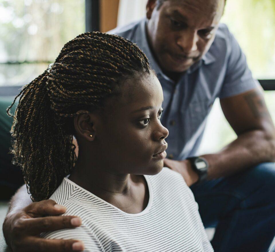 man helping woman overcome depression