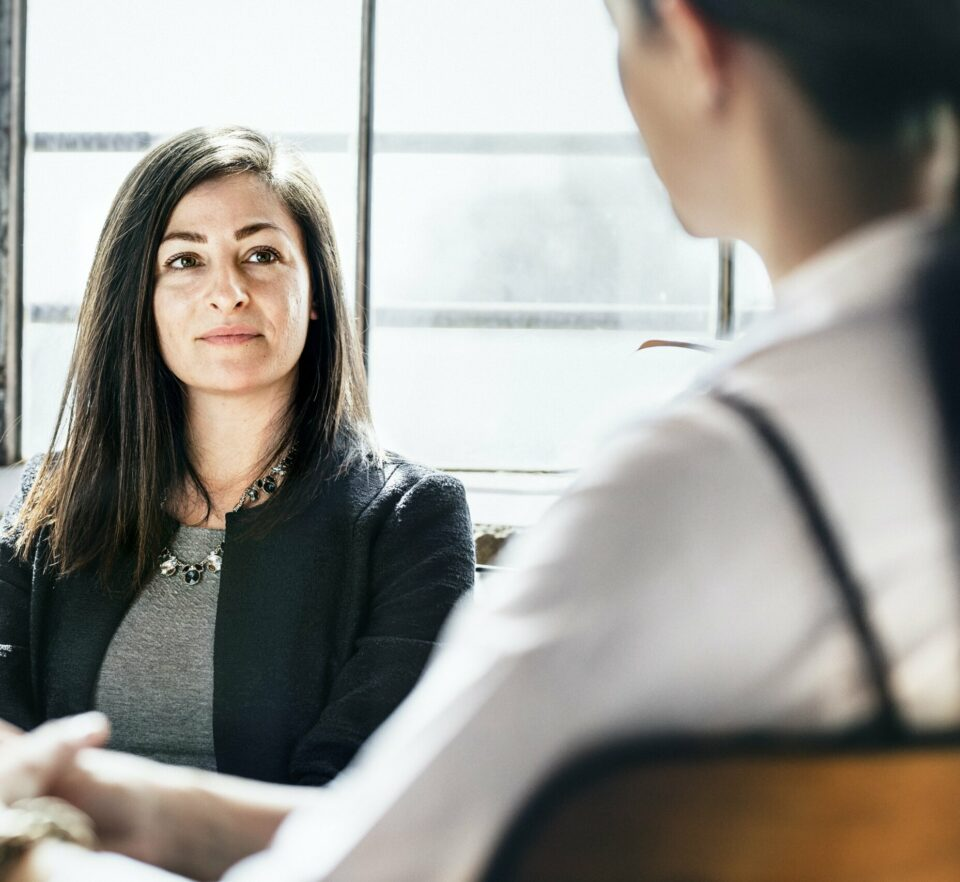 woman talking to therapist getting help